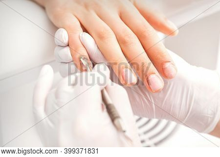 Closeup Of Beautiful Womans Fingernails Receiving Cleaning Cuticle With Manicure Pusher Tool While G