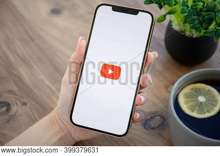 Alanya, Turkey - December 6, 2020: Woman Hand Holding Apple Iphone 12 Pro Max Gold With App Youtube