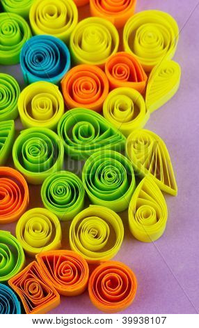 Colorful quilling on purple background close-up poster