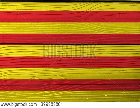 Flag Of Catalonia On Wooden Wall Background. Grunge Catalunya Flag Texture, The Red Stripe On Golden