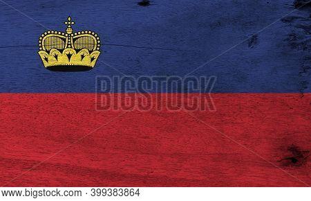 Flag Of Liechtenstein On Wooden Plate Background. Grunge Liechtensteiner Flag Texture, Blue And Red,