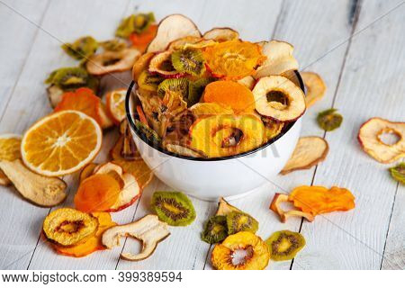 Organic Healthy Assorted Dried Fruit Mix Close Up. Dried Fruit Snacks. Dried Apples, Mango, Feijoa,