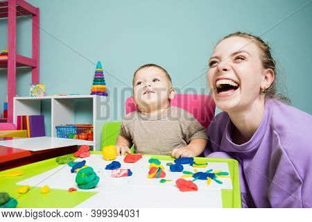 Teacher And Baby Have A Great Time In The Kindergarten