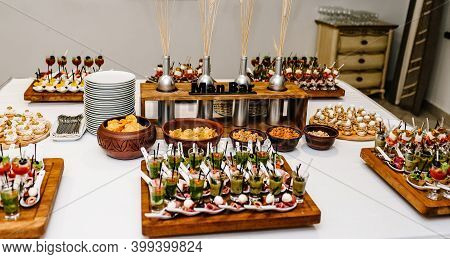 Man Bar. Plates On The Table With Gourmet Variety Of Mini Appetizers With Different Toppings. Assort
