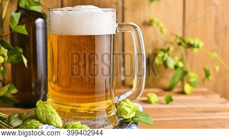 Beer. Cold Craft Light Beer In A Glass With Water Drops. Pint Of Beer Close Up On A Wooden Backgroun