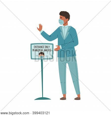 Young African American Man In Medical Mask Standing Controlling Observation Of Mask Mandate Before E