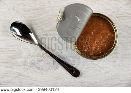 Teaspoon, Opened Jar With Pollock Roe On Wooden Table. Top View