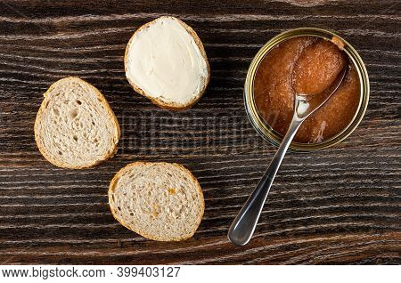Slices Of Wheat Bread, Sandwich With Butter, Teaspoon In Opened Jar With Pollock Roe On Dark Wooden