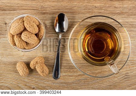 Crispy Oat Pillows With Filling In White Bowl, Few Crispy Pillows, Teaspoon, Tea In Cup On Saucer On