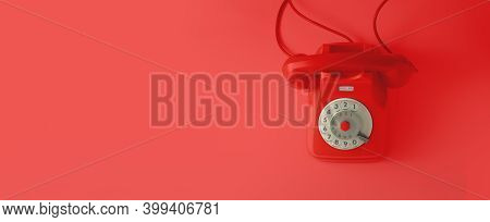 A Red Vintage Dial Telephone With Red Background.
