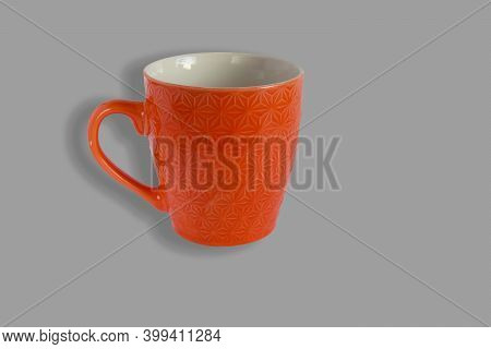 One Empty Orange Cup On A Stark Gray Background