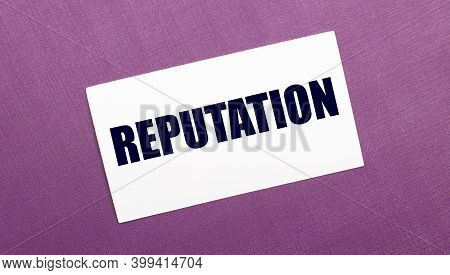 On A Lilac Background, A White Card With The Word Reputation