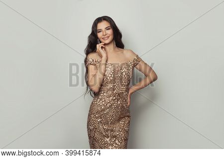 Attractive Woman Brunette In Fashionable Evening Gown On White Background