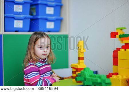 Happy Little Girl With Toy. Little Girl Playing In The Playroom.