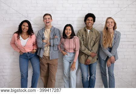 Blog About Student Life, Friendship And Modern Study Exchange. Cheerful Teen Multiracial Students Te
