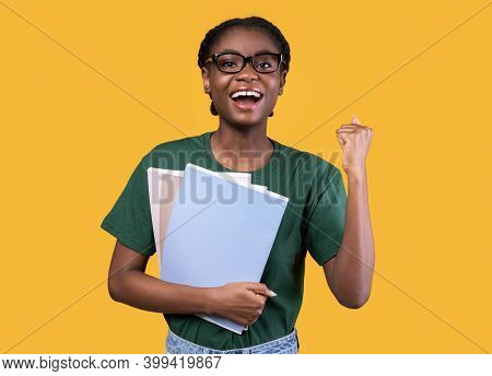 African Student Girl Gesturing Yes After Successful Exam Holding Notebooks Posing Smiling To Camera