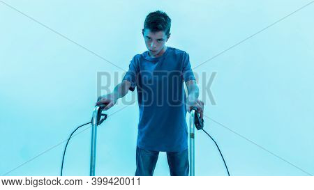 Cropped Shot Of Teenaged Disabled Boy With Cerebral Palsy Looking At Camera, Taking Steps With His W