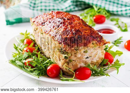 Tasty Homemade Ground Baked Chicken Meatloaf With Green Peas And Sliced Broccoli On White Table. Foo