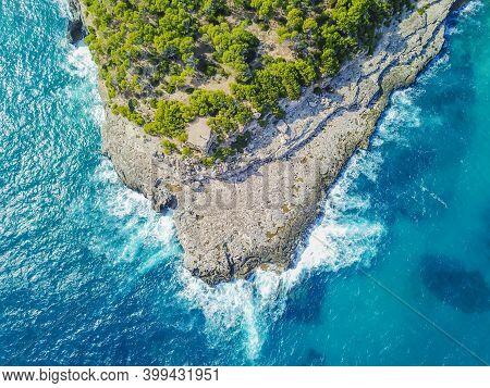 Drone Above Bay And Punta De Sa Guardia Of Cala Mondrago Samarador In Mallorca Balearic Islands Spai