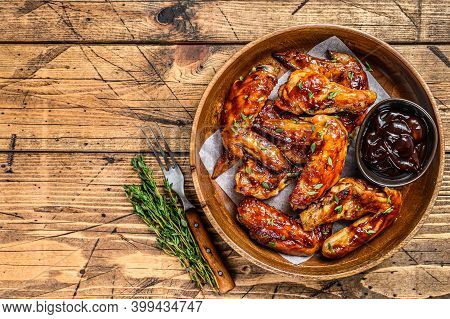 Grilled Chicken Wings With Bbq Sauce. Wooden Background. Top View. Copy Space