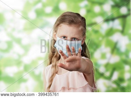 Stop! The Concept Of Limiting The Distance Between People During The Coronavirus. Little Girl In Pro