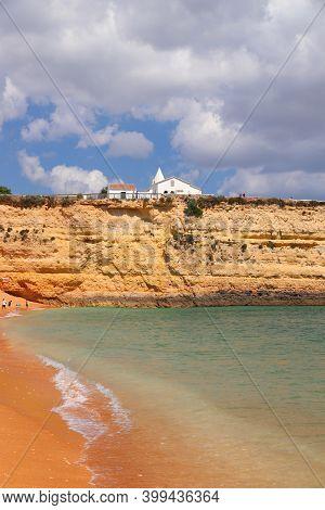 Algarve, Portugal - Senhora Da Rocha Beach With White Chapel. Lagoa Municipality.