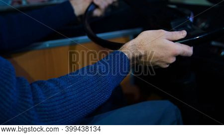 Close-up Of Man Driving Tractor. Media. Man Turns Steering Wheel Of Old Tractor. Man Driving Tractor