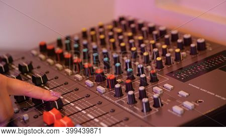 Close-up Of Man Setting Up Mixing Console. Media. Recording Equipment With Sound Engineers Mixing Co