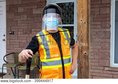 Medium Close Shot Of A Man Wearing An Orange Fluo Visibility Jacket, Covid Protective Face Mask And