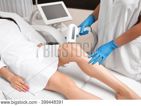 Elos Epilation Hair Removal Procedure On A Woman's Body. Beautician Doing Laser Rejuvenation On The