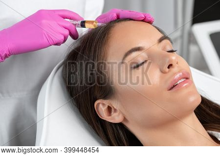Cosmetologist Does Prp Therapy Against Hair Loss And Anti-dandruff Of A Beautiful Woman In A Beauty