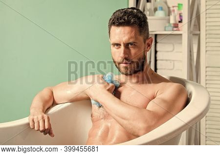 Man Wash Muscular Body With Foam Sponge. Wash Off Foam With Water Carefully. Sex And Relaxation Conc