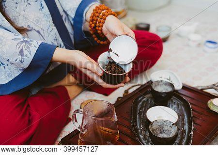 Tea Ceremony. Tea Master Brews Tea In Beautiful Chinese Dishes. Puer Tea.
