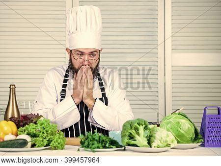Man Bearded Chef Getting Ready Cooking Delicious Dish. Chef At Work Starting Shift. Guy In Professio