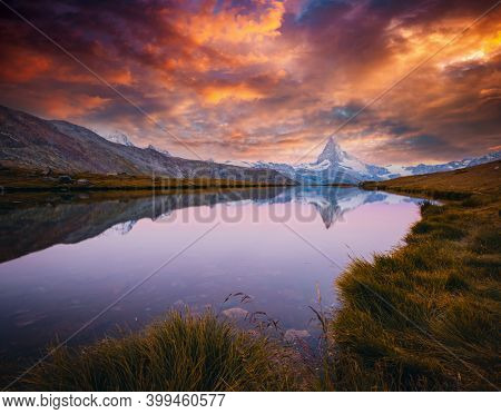 Most splendid Matterhorn spire under the evening sky. Location place Stellisee lake, Cervino peak, Switzerland, Europe. Image of popular touristic place. Photo wallpaper. Discover the beauty of earth.