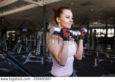 Fitness Woman Doing Workout In Gym With Dumbbells