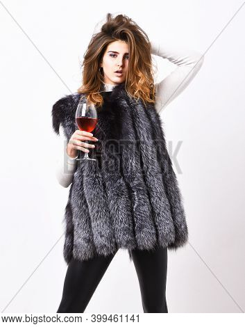 Woman Drink Wine Wear Luxury Fur Clothing. Luxury Lifestyle Concept. Fashionable Lady Likes Luxury.