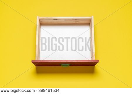Top View With An Empty Drawer Isolated On A Yellow Background. Wooden Drawer With White Interior, Vi