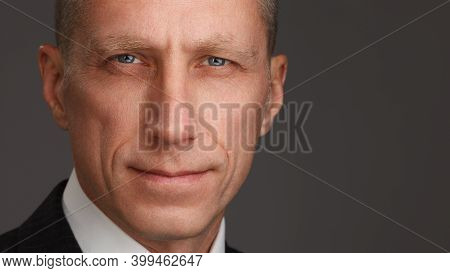 Close Up Portrait Shot Of An Attractive And Successful Middle Aged Man Male. Middle-aged Man Looking