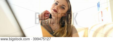 Charming Lady Guitarist Looking At Camera And Smiling While Holding Acoustic Musical Instrument