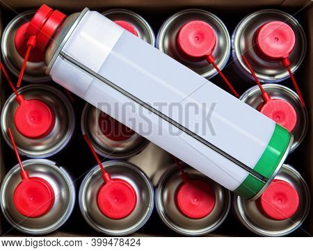 Spray Bottle On Many Cylinders Standing In A Box At A Shallow Depth Of Field