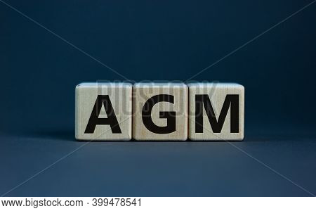 Agm Symbol. Concept Word 'agm' - 'annual General Meeting' On Cubes On A Beautiful Wooden Table. Whit