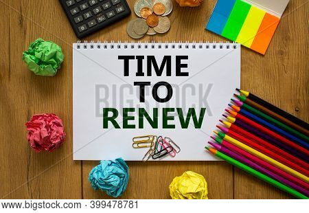 Tome To Renew Symbol. White Note With Words 'time To Renew' On Beautiful Wooden Table, Colored Paper