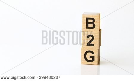 B2g - Acronym From Wooden Blocks With Letters, Business-to-government. White Background.