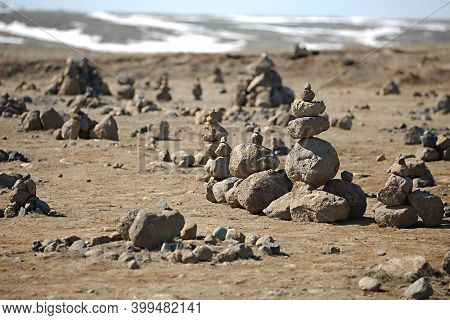 Stone cairns erected on the way in a barren landscape