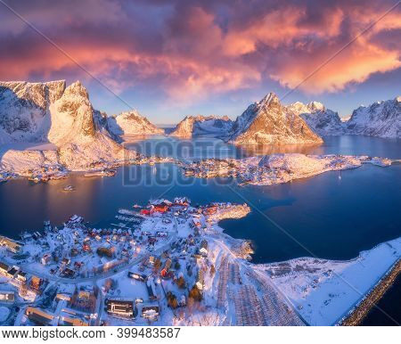 Colorful Landscape With Blue Sea, Snowy Mountains, High Rocks, Village With Buildings, Rorbu, Sky Wi