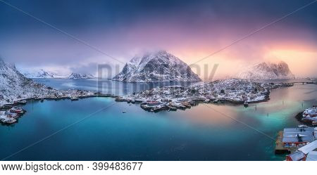 Aerial View Of Blue Sea, Snowy Mountains, High Rocks, Village With Buildings, Rorbu, Colorful Sky, R