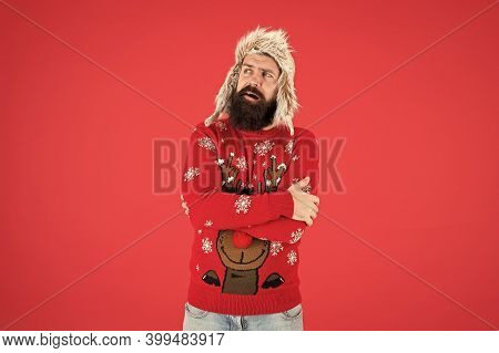 Stay Warm In Style. Bearded Man Feel Cold Red Background. Hipster Shiver Of Cold. Festive Fashion Tr