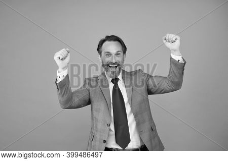 Victory Is The Goal. Happy Businessman Celebrate Victory. Mature Man With Raised Hands Grey Backgrou