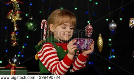 Child Looking For Presents, Gift For Friends And Family, Doing Shopping Online Using Mobile Phone Is
